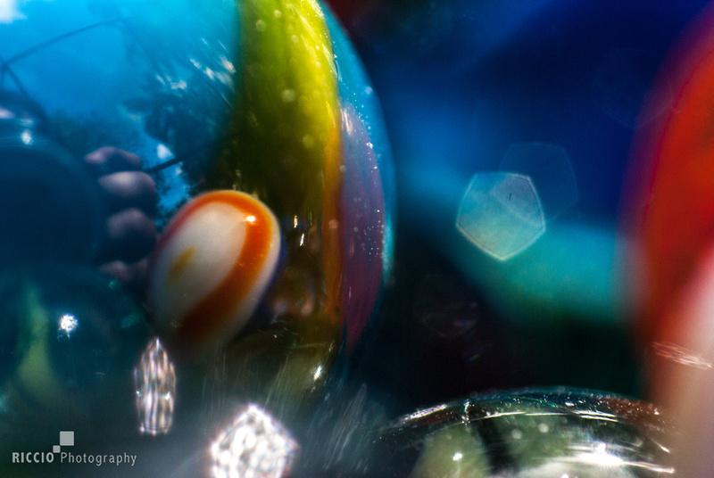 Macro photography of marbles by Maurizio Riccio