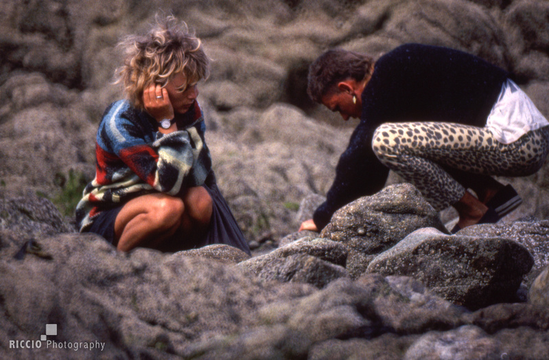 A young man and woman on rocks