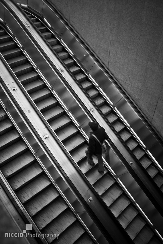 Person going up escalator in Washington, D.C. By Maurizio Riccio