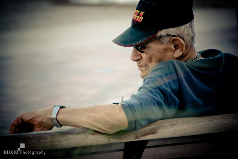 Old man checking his watch photographed by Maurizio Riccio