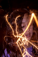 Light painting of kids with sparklers. Photographed by Maurizio Riccio