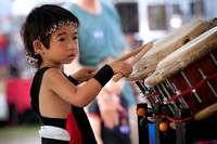 Young asian kid playing the drums