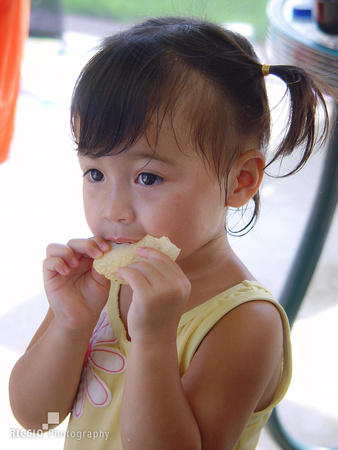 Young girl snacking