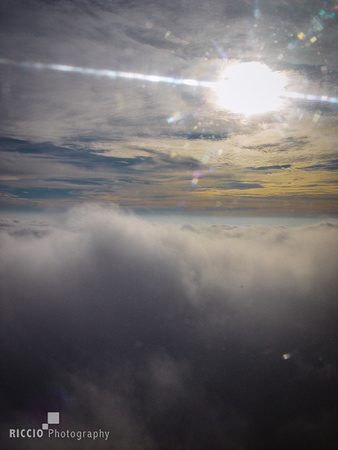 Views of the sky from commercial jet, photographed by Maurizio Riccio