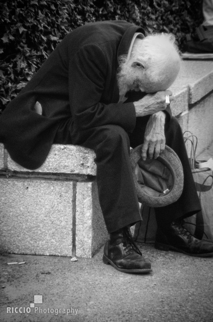 Tired old man. Photographed by Maurizio Riccio.