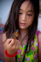 Child holding a butterfly. Photographed by Maurizio Riccio